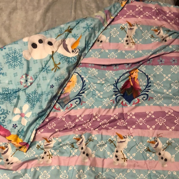 A reversible Frozen comforter
